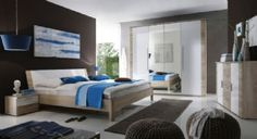 This unique Klio bedroom suite includes a large wardrobe, bed, bed side tables and a chest of drawers. Beautiful wooden edges with high gloss white inserts. Source:http://www.chromatiche.com/bedroom-6-c.asp #luxurybedroom #latestbedroom #contemporarybedroom #furnitureuk #furnitureshopuk #bedroomfurnitureuk