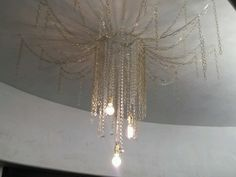 Custom designed chain and crystal light installation by Lezley Lynch Designs for the 2014 Oklahoma City Symphony Show House.