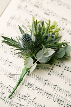 Classic Spring Country House Wedding Thistle Buttonhole http://www.jobradbury.co.uk/