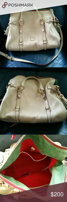 Dooney Bourke florentine satchel creme Genuine used Dooney and Bourke satchel in good condition no tears or rips. Some wear and darkened areas where it rubs on jeans. Please see pics and asks questions before buying. This purse comes from a smoke and pet free environment. Inside it is clean also no tears no major stains. All hardware is in tact and working includes long strap. Note inside trademark green suede with red cotton interior. Dooney & Bourke Bags Satchels