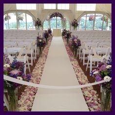 Altar Arch, arrangements, aisle arrangements, rose petals.   Straight parallel lines of rose petals down the aisle.
