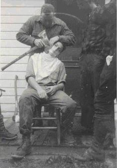 Lumberjack Shaving With An Axe, 1930s