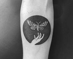 Tomtom's fantastical vignettes are reminiscent of tattooist Eva Krbdk's tiny work. #tomtomtattoos #negativespacetattoos #blackworktattoos #scene360 #butterflytattoos #insecttattoos
