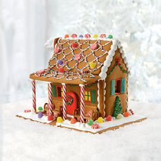 Gingerbread House Ideas | Gingerbread House with a candy cane porch!