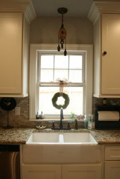 Farm house sink, pulley pendant light  4 Bedroom, 2.5 Bath   Clifton Development Group, LLC.