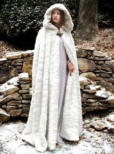 Snow Queen Cape is a beautiful, long flowing white faux fur cape. This magnificent cape and the attached hood both feature a full white satin lining. This popular item has a silver toned leaf clasp at the neck. White Cloak, White Cape, Mantel Trenchcoat, Gothic Mode, Fur Cape, Medieval Costume, Medieval Clothing, Women's Clothing, Cosplay Costumes