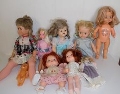 """You are looking at a  collection of 9 vintage dolls. These old dolls have various manufacturers including Topper Co, Impco, Eegee, Mattel, American Greetings, Fisher Price and others. They vary in size from about 8"""" to about 26"""". They are all in played with condition and none have been tested. They were an estate find and may have a smell from storage. All clothing pictured will be included."""