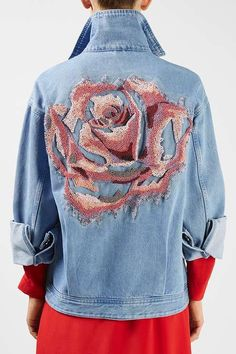 Casual meets couture with the Rushmore Jacket. Featuring a sensational rose print beaded embroidery to the back, this light wash denim jacket is a fashion collector's item. #Topshop