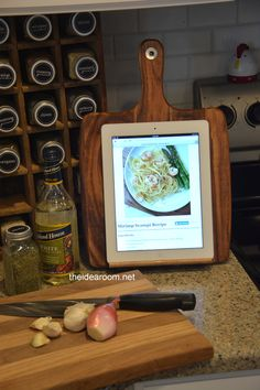 GENIUS!  iPad holder - for recipes or streaming while you're cooking in the kitchen!!!