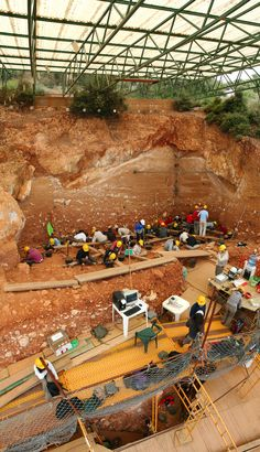 """Archaeological Site of Atapuerca. The caves in the Atapuerca Mountains contain fossil remains of the earliest 6th-day - beings discovered in Europe dating from nearly one million years ago. The Sima de los Huesos or """"Pit of Bones"""" contains the world's largest collection of hominid fossils."""