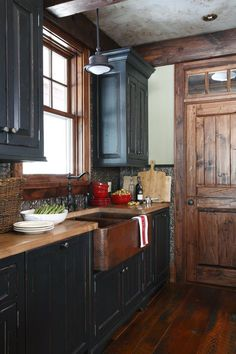 Country Kitchen | Blue painted cabinetry and a copper hand hammered sink | Styling