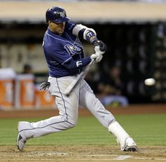 Tampa Bay Rays' Yunel Escobar connects for an RBI single off Oakland Athletics' Jarrod Parker in the second inning of a baseball game Friday, Aug. 30, 2013, in Oakland, Calif. (AP Photo/Ben Margot)