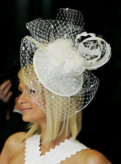 Paris Hilton in a white  fascinator