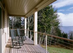 The porch of this coastal Maine home offers gorgeous views of the Atlantic Ocean.