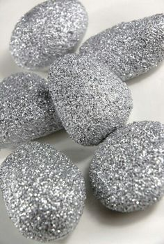 Gather rocks, paint with glue & roll in glitter of your choice. Put them in vases for a pretty & simple centerpiece.