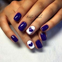 Deep navy blue nails with white nail polish on ring fingers topped off with navy blue he?rt accent. Perfect for, Valentines Day! ?