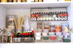 I love TidyMom's idea for storing cupcake wrappers in a tall spaghetti jar. I put all of my mini cupcake wrappers in a shorter jar. My toothpick and skewer collection was placed into individual containers- mostly candle votives. I used clear plastic cups to store my decorating tips and gels, and a tall cup to store my disposable piping bags.