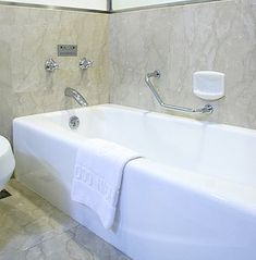 """An alcove or """"recessed"""" tub is typically rectangular in shape and Most usually come with an integral tiling flange on 3 sides. This is a small vertical lip that fits up under the surrounding wall tile or shower enclosure."""