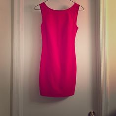 Red backless dress with bow Soft cotton/spandex material. More conservative front, with sexy open back. Worn once, great condition. Dresses Mini