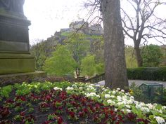View towards Edinburgh Castle, with flowers in the foreground at the base of the monument to Sir James Young Simpson. Stay nearby at Craigwell Cottage - a self-catering property in the heart of Edinburgh.  Within easy walking distance of Princes Street. More at: http://www.2edinburgh.co.uk