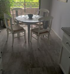 Kitchen update: new porcelain tile floor and painted out wood table and chairs