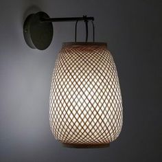 Titouan Bamboo & Rice Paper Wall Light by E. Gallina AM.PM The Titouan wall light, an Emmanuel Gallina creation, exclusively for AM. A combination of an artisan style and contemporary design. Natural Wall Lights, Black Wall Lights, Bamboo Rice, Style Artisanal, Bamboo Structure, Home Furnishing Accessories, Luminaire Design, Rice Paper, Home Interior