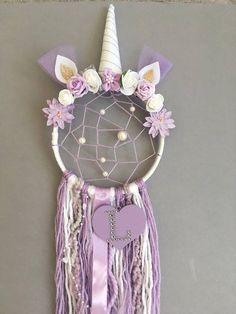 Make your little girls dreams come true, whilst catching the bad ones, with this one of a kind Unicorn Dream Catcher with extra added details of webbing, beads and the initial of your choice. Measurements: 6inch hoop/25-30cm tassel length These are unique made to order items and can be