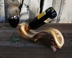 Im going to need this. https://www.etsy.com/listing/175418242/rustic-log-wine-holder-aspen-wood-home