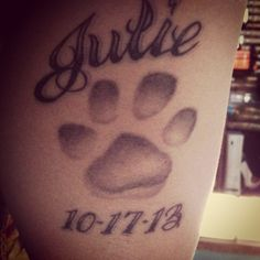 My own tattoo of my dogs' paw print! Name and date makes it personal