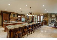 Massive kitchen with two full-width islands. One island offers seating for eight people.
