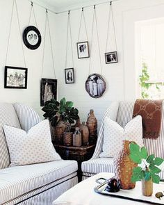 Along dining room back wall? Notice how the accessories give character to this space- hanging photos, vintage jugs. Hanging Frames, Hanging Photos, Picture Rail Hanging, Picture Hangers, Hygge, Flea Market Decorating, Decorating Ideas, Ticking Stripe, Ticking Fabric