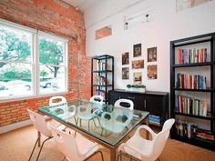 Love the exposed brick walls in this dining room in a high-rise Dallas condo. #architecture #house #design #chairs #table #bookshelf