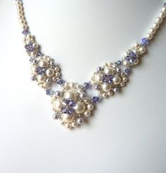 This necklace is made in your choice of high quality Swarovski white or ivory/cream pearls in varying sizes and blended with Swarovski tanzanite