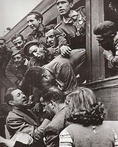 Volunteer anti-communist Spanish troops off to defeat communist Russia in 1941. http://www.mve2gm.es/paises/bando-del-eje/division-azul-/