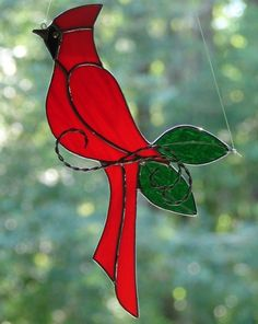 This lovely stained glass bird is hand crafted from a beautiful bright. Each of my stained glass pieces are individually hand crafted. wispy red glass and is accented with cathedral green glass. Stained Glass Cardinal, Stained Glass Ornaments, Stained Glass Birds, Stained Glass Christmas, Stained Glass Suncatchers, Stained Glass Crafts, Faux Stained Glass, Stained Glass Designs, Stained Glass Patterns