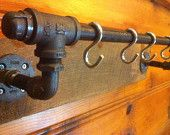 Industrial Pipe ... coat rack/ pot rack/ towel rod etc... Great Idea via this etsy shop or DIY.  We made a rack in the laundry room w/o the hooks.