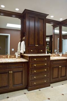 double vanities with towers center  of this vanity area including bathroom tower storage Double