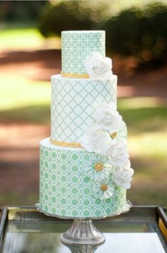 wedding cake. love the mint and gold. PS I WILL practice making cakes if you want me to try and make yours so you don't end up with that garbage from roseaurs or wherever... @Montana James