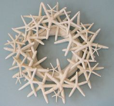 Coastal Christmas Wreaths l Starfish make beautiful tree toppers and traditional wreaths more interesting. l www.CarolinaDesigns.com