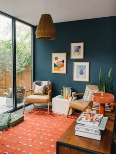 Bright and Colorful Playroom with lots of storage, vintage flat weave rug and cool art
