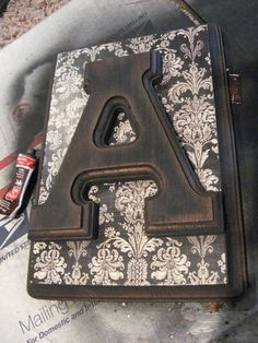 DIY Monogram plaques:  unfinished wood plaque  paint  scrapbook paper and wooden letter