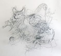 wire art sculptor Elizabeth Berrien with fox, owl,sea shells, runner human figure, cat kitty, tree, feather, owl, and spider web wire sculpture.