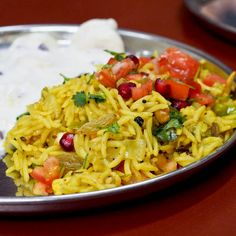 A classic #Indian #rice dish - Vegetable Biryani. Incredibly flavorful thanks to the help of various fragrant spices, nuts, fruits, and all those colorful veggies. #glutenfree #vegan