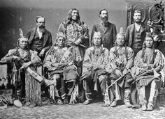 Crow delegation in Washington:  standing from left: M. Quivly (interpreter), Two Belly, Augustus R. Keller (Crow agent), T. Stewart (interpreter).  Sitting from left: Old Crow, Medicine Crow, Long Elk, Plenty Coups, Pretty Eagle. - No date. Photographer not known. (Photoshopped copy)