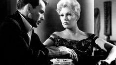 The Man with the Golden Arm (1955)  Frank Sinatra, Kim Novak, Eleanor Parker Director: Otto Preminger IMDB: Frankie Machine is a skilled card dealer and one-time heroin addict. When he returns home from jail, he struggles to find a new livelihood and to avoid slipping back into addiction.