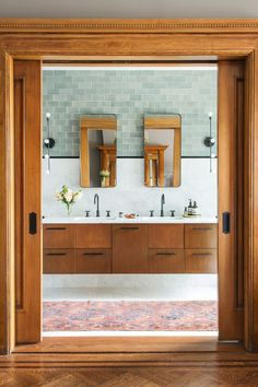 Love the tile detail, and the mix of old architectural features and floors with more (mid-century) modern!
