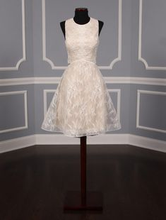 This beautiful Nha Khanh Melissa wedding dress is Brand New!  It is made from very feminine ivory lace with a champagne color lining. There are sheer tulle cutouts on the sides of the gown and a sheer back. This dress is sleeveless with a scoop neck and an a-line silhouette. You could wear this lace dress for your bridal shower, party, rehearsal dinner, reception, destination wedding or any type of wedding venue! Beach Wedding, bridal shower, Cocktail, Rehearsal, Romantic #2020bride…