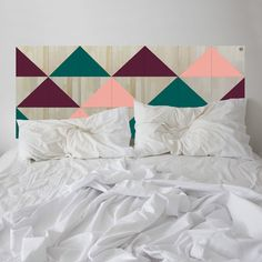 In bloom. Lose yourself in the contemporary style of the BERMUDA headboard. It features a series of coloured triangles forming a tessellated pattern hand-painted on eco-wood squares.