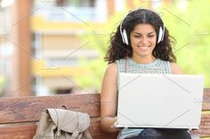 Freelancer working with a laptop in a park.jpg. Technology Photos