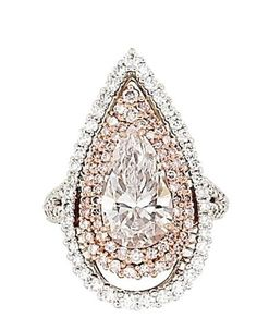 A coloured diamond and diamond ring/pendant